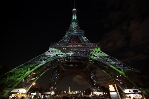 The Eiffel Tower is lit with green lights as part of the events in the French capital to mark the World Climate Change Conference 2015 (COP21), in Paris, France, December 2, 2015. (Eric Gaillard/Reuters)