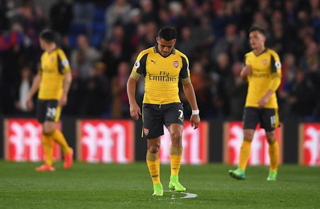 <p>Alexis Sanchez looks despondent after Arsenal fall behind</p>