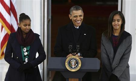 U.S. President Obama and his daughters Malia and Sasha appear at the North Portico of the White House to pardon the annual Presidential turkey in Washington
