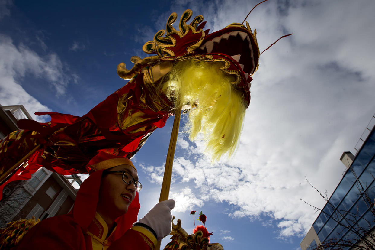 People from the Chinese community celebrate the Lunar New Year, the year of the Rooster, in Madrid, Spain Saturday Jan. 28, 2017. (AP Photo/Paul White)