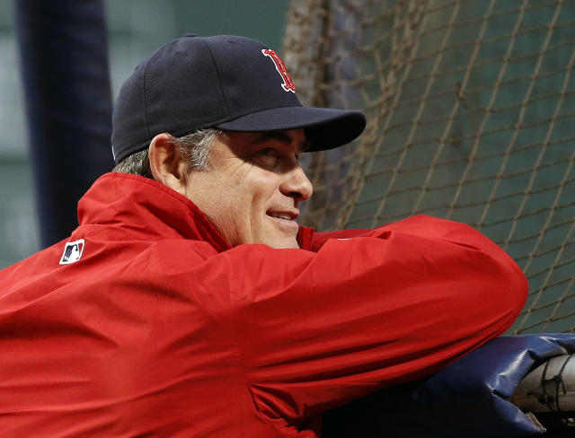 Boston Red Sox manager John Farrell watches batting practice before Game 1 of baseball's World Series against the St. Louis Cardinals Wednesday, Oct. 23, 2013, in Boston. (AP Photo/Elise Amendola)