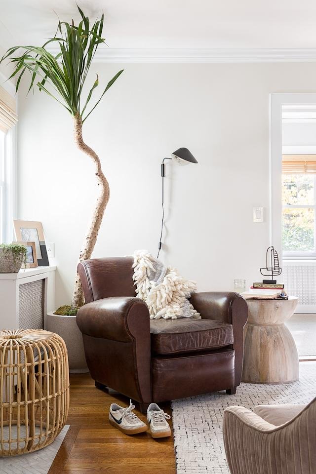 """<p>Although <a href=""""https://www.marthastewart.com/2126982/how-to-layer-your-lighting"""">ambient lighting</a> is essential to a well-designed living room, large table lamps are often a waste of precious space. """"When space is tight, skip table lamps and instead opt for a wall sconce,"""" says Hur. """"This is a chic way to free up table space while still ensuring your room is well lit.""""</p>"""