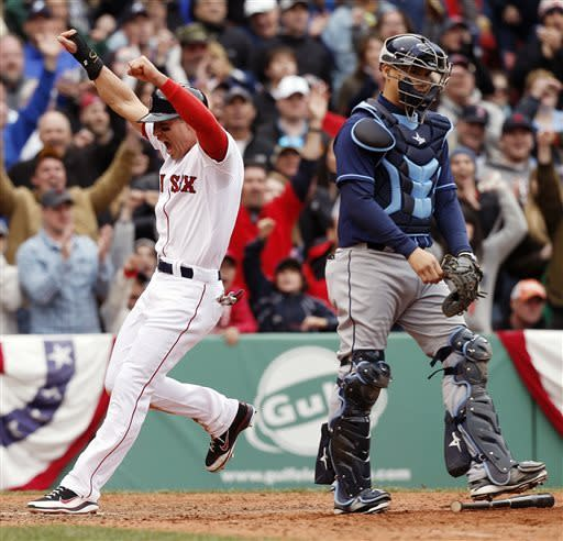 CORRECTS ID AT RIGHT TO JOSE LOBATON, NOT JOSE MOLINA - Boston Red Sox's Jacoby Ellsbury, left, celebrates behind Tampa Bay Rays' Jose Lobaton as he scores the game-winning run on an RBI single by teammate Shane Victorino in the 10th inning of a baseball game in Boston, Saturday, April 13, 2013. The Red Sox won 2-1. (AP Photo/Michael Dwyer)