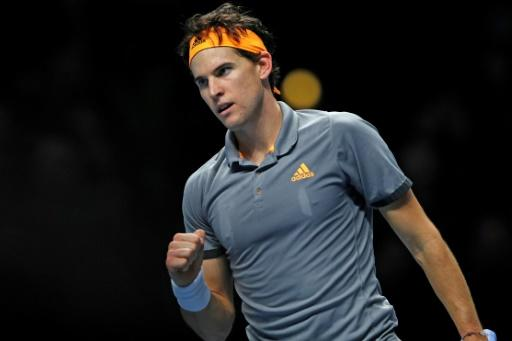 Austria's Dominic Thiem beat Roger Federer in their ATP Finals opener
