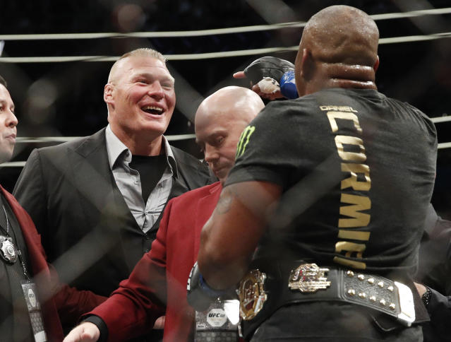 Brock Lesnar, left, taunts Daniel Cormier after Cormier's heavyweight title mixed martial arts bout at against Stipe Miocic at UFC 226, Saturday, July 7, 2018, in Las Vegas. (AP Photo/John Locher)