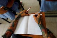 An inmate writes during an English lesson inside Klong Prem high-security prison in Bangkok, Thailand July 12, 2016. REUTERS/Jorge Silva