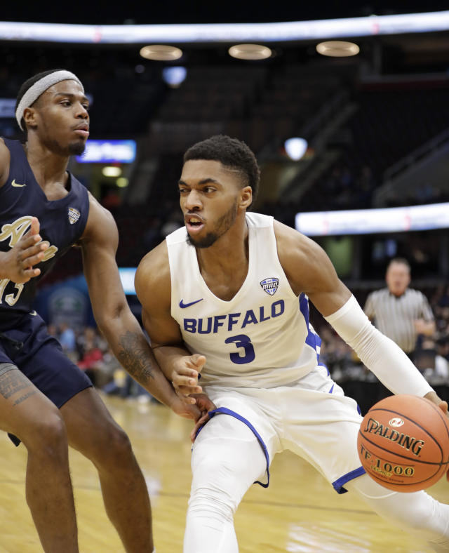 Buffalo's Jayvon Graves (3) drives past Akron's Jeremy Roscoe (13) during the second half of an NCAA college basketball game at the Mid-American Conference tournament, Thursday, March 14, 2019, in Cleveland. Buffalo won 82-46. (AP Photo/Tony Dejak)