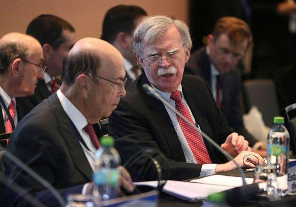 PHOTO: National security adviser John Bolton, right, speaks with U.S. Commerce Secretary Wilbur Ross during a conference of more than 50 nations that largely support opposition leader Juan Guaido in Lima, Peru, Aug. 6, 2019. (Martin Mejia/AP)