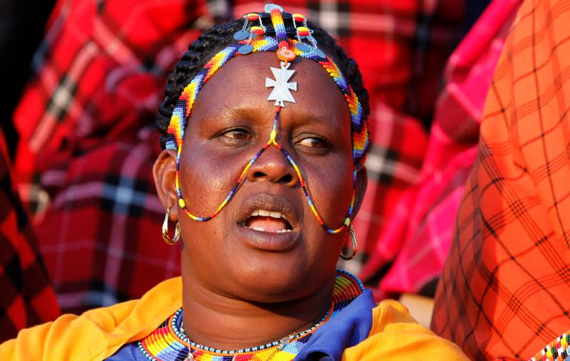 A Maasai woman dressed in traditional regalia attends a memorial service for late former Kenya's President Daniel Arap Moi at the Nyayo Stadium in Nairobi