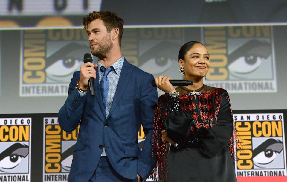 SAN DIEGO, CALIFORNIA - JULY 20: Chris Hemsworth and Tessa Thompson speak at the Marvel Studios Panel during 2019 Comic-Con International at San Diego Convention Center on July 20, 2019 in San Diego, California. (Photo by Albert L. Ortega/Getty Images)