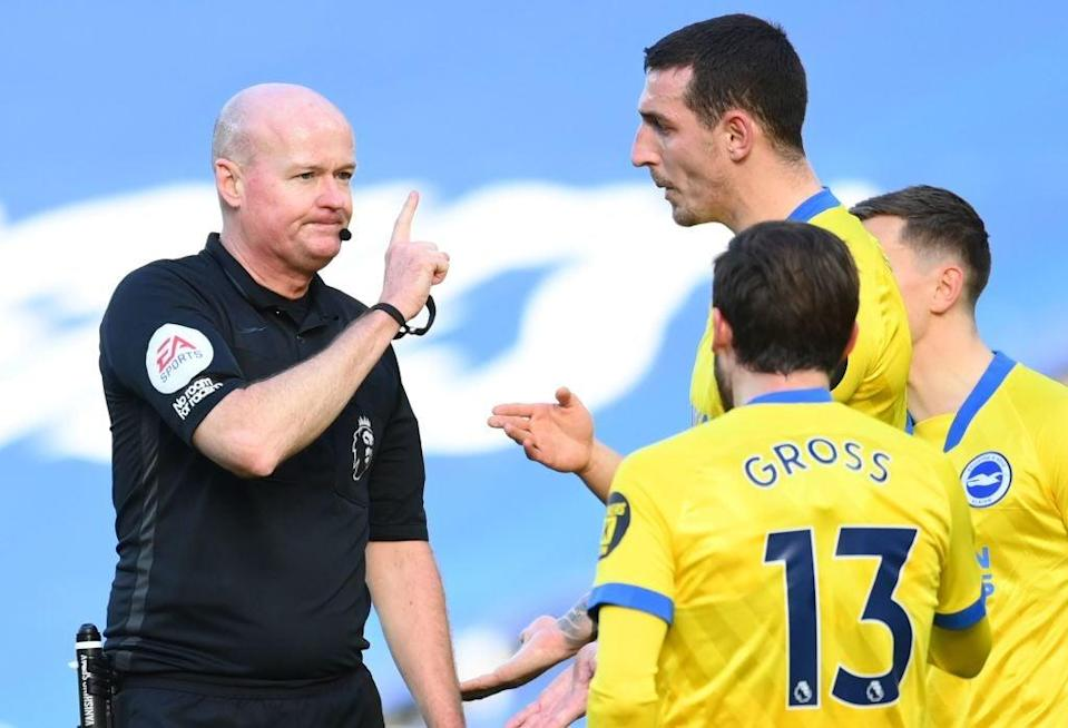 <p>Lewis Dunk remonstrates with Referee Lee Mason</p> (Getty)