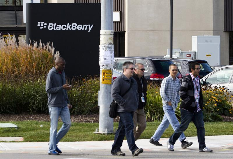 People walk in front of the Blackberry campus in Waterloo