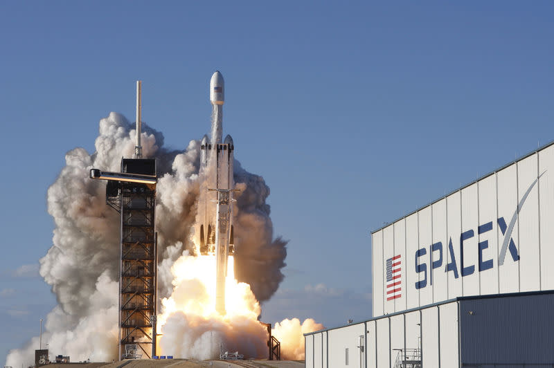 A SpaceX Falcon Heavy rocket, carrying the Arabsat 6A communications satellite, lifts off from the Kennedy Space Center