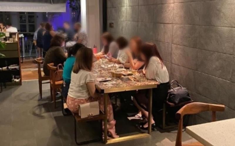 A group of seven patrons were found seated at a table at a Duxton Hill restaurant on 25 September 2020. (PHOTO: Urban Redevelopment Authority)