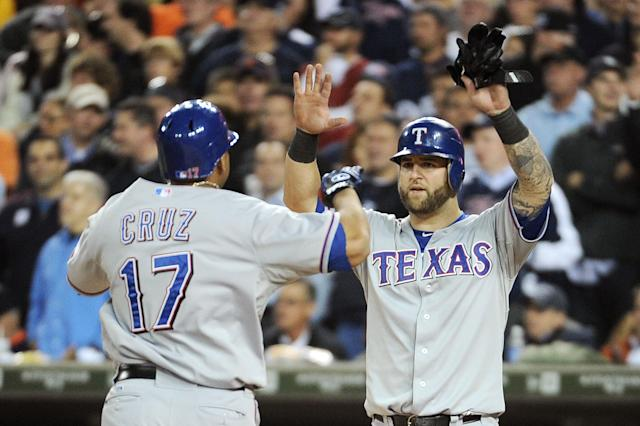 DETROIT, MI - OCTOBER 13: Nelson Cruz #17 and Mike Napoli #25 of the Texas Rangers celebrate after Cruz's two-run home run in the eighth inning of Game Five of the American League Championship Series against the Detroit Tigers at Comerica Park on October 13, 2011 in Detroit, Michigan. (Photo by Harry How/Getty Images)