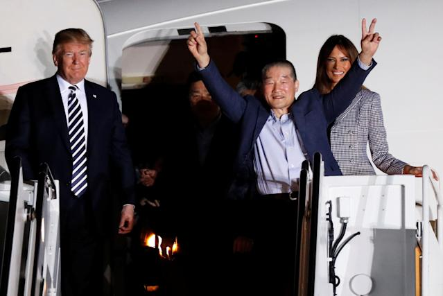 <p>One of the Americans formerly held hostage in North Korea gestures next to President Donald Trump and first lady Melania Trump, upon their arrival at Joint Base Andrews, Md., May 10, 2018. (Photo: Jim Bourg/Reuters) </p>