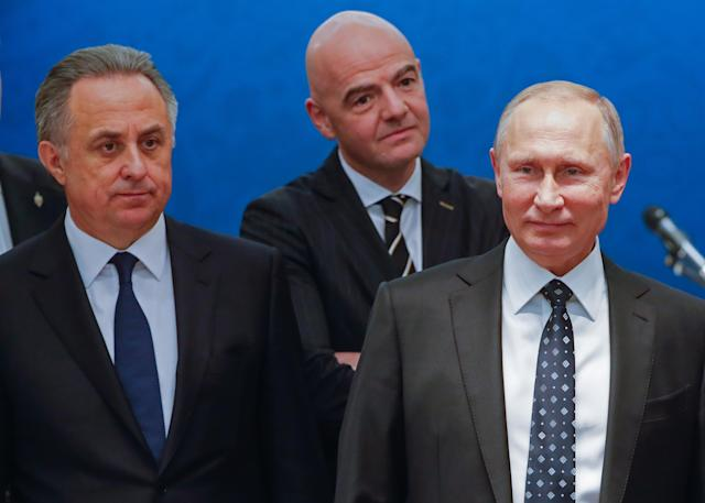 Vitaly Mutko (left) with FIFA president Gianni Infantino (center, back) and Russian president Vladimir Putin (right). (Getty)