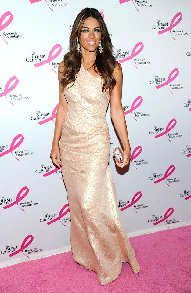 """Elizabeth Hurley is also a fan of the hue and wowed the crowd upon arriving at the 2011 Breast Cancer Research Foundation's Hot Pink Party in a shimmering, asymmetrical J. Mendel gown and chandelier earrings. Jamie McCarthy/<a href=""""http://www.wireimage.com"""" target=""""new"""">WireImage.com</a> - April 14, 2011"""