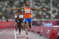 Sifan Hassan, of the Netherlands, celebrates as she crosses the finish line to win the women's 5,000-meters final at the 2020 Summer Olympics, Monday, Aug. 2, 2021, in Tokyo. (AP Photo/Petr David Josek)