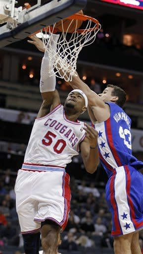 Charlotte Bobcats' Corey Maggette (50) dunks against New Jersey Nets' Kris Humphries (43) in the first half of an NBA basketball game in Charlotte, N.C., Friday, March 9, 2012. (AP Photo/Bob Leverone)