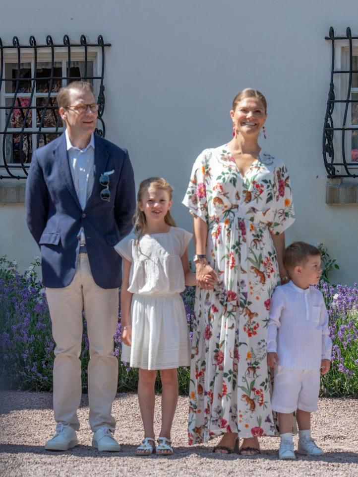 <p>Crown Princess Victoria smiles with her husband, Prince Daniel, and their two children, Princess Estelle and Prince Oscar, at Victoria's 42nd birthday celebration.</p>