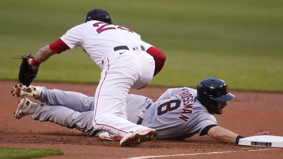 Detroit Tigers' Robbie Grossman (8) dives back safely to first as Boston Red Sox first baseman Bobby Dalbec catches the pick-off throw during the first inning of a baseball game at Fenway Park, Tuesday, May 4, 2021, in Boston. (AP Photo/Charles Krupa)