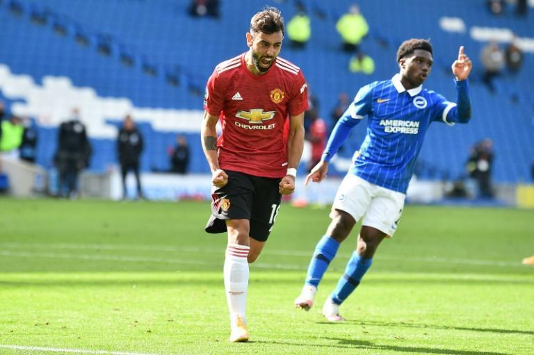 Just in time: Bruno Fernandes's 100th minute penalty secured a dramatic 3-2 win for Manchester United over Brighton