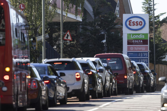 LONDON, UNITED KINGDOM - SEPTEMBER 24: A queue forms for an Esso petrol station on September 24, 2021 in London, United Kingdom. BP and Esso have announced that its ability to transport fuel from refineries to its branded petrol station forecourts is being impacted by the ongoing shortage of HGV drivers and as a result, it will be rationing deliveries to ensure continuity of supply. (Photo by Dan Kitwood/Getty Images)