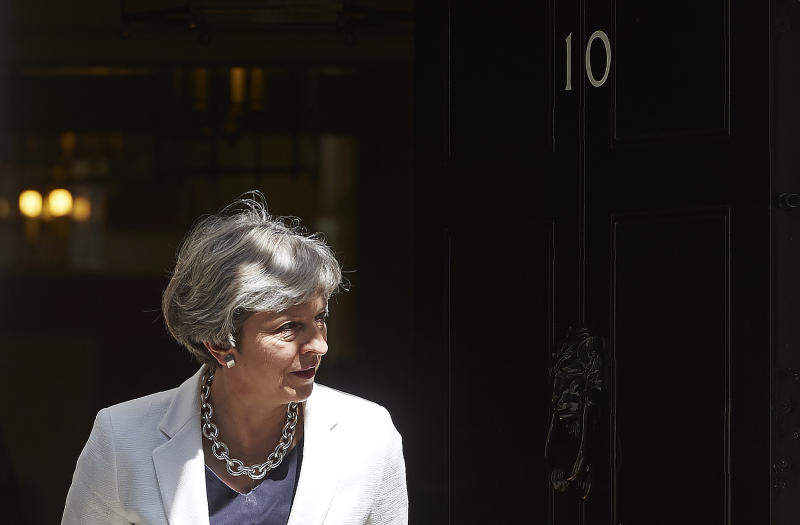 Theresa May exits 10 Downing Street in central London on July 18, 2017: AFP/Getty Images