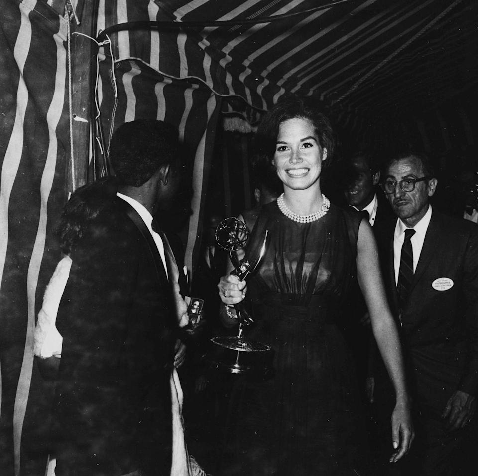 <p>Moore holding her Emmy Award behind the scenes at the ceremony.</p>