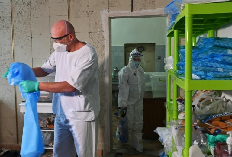 Medical workers don protective gear before treating coronavirus patients at Kiev's clinical hospital № 17