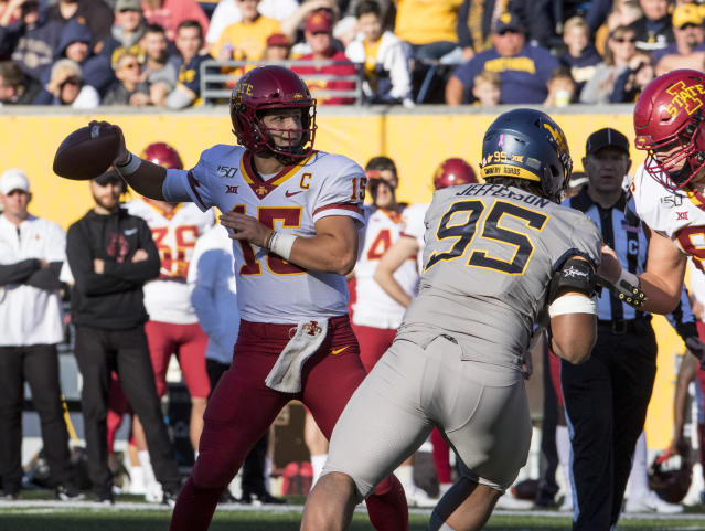 Iowa State quarterback Brock Purdy (15) attempts a pass during the first half of an NCAA college football game against West Virginia, Saturday, Oct. 12, 2019, in Morgantown, W.Va. (AP Photo/Raymond Thompson)