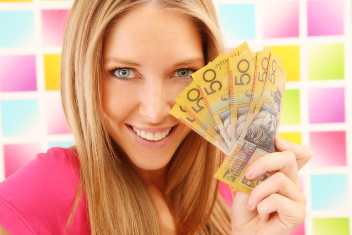Woman in pink on colorful square background with australian money