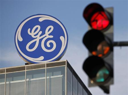 The logo of the GE Money Bank is seen behind a traffic light in Prague