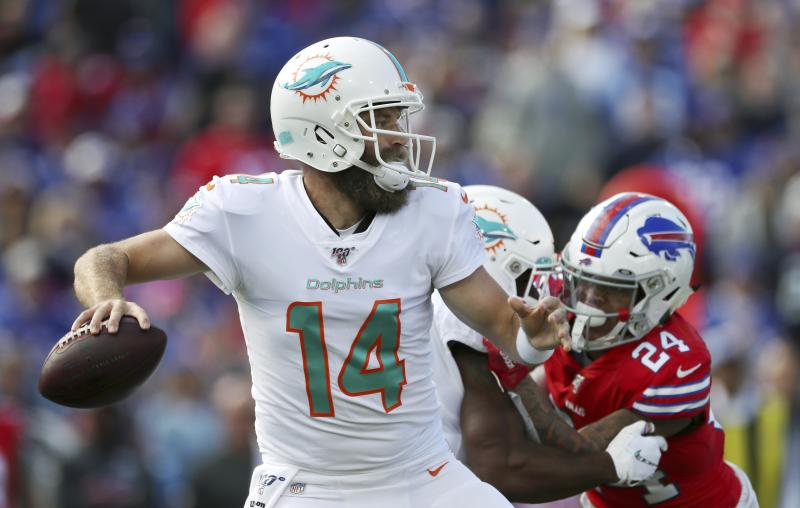 Miami Dolphins quarterback Ryan Fitzpatrick drops back to pass under pressure from Buffalo Bills cornerback Taron Johnson, right, in the first half of an NFL football game, Sunday, Oct. 20, 2019, in Orchard Park, N.Y. (AP Photo/Ron Schwane)