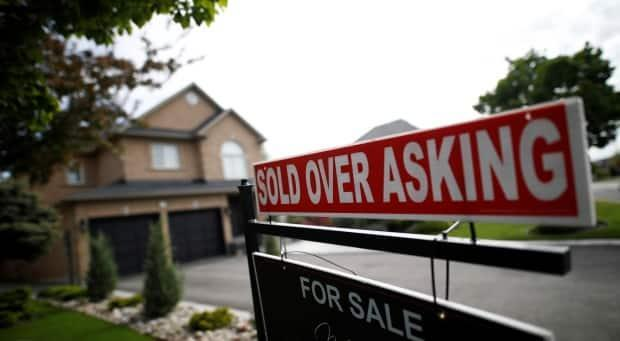 The pandemic has created a frenzy in Canada's housing market, as low rates coupled with people being cooped up at home has caused them to be willing to bid more and more for extra space. (Mark Blinch/Reuters - image credit)