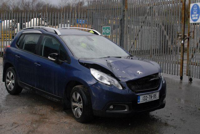A blue Peugeot 2008 with damage consistent with a collision that was found abandoned off Queens Road, Miles Platting (Greater Manchester Police/PA)