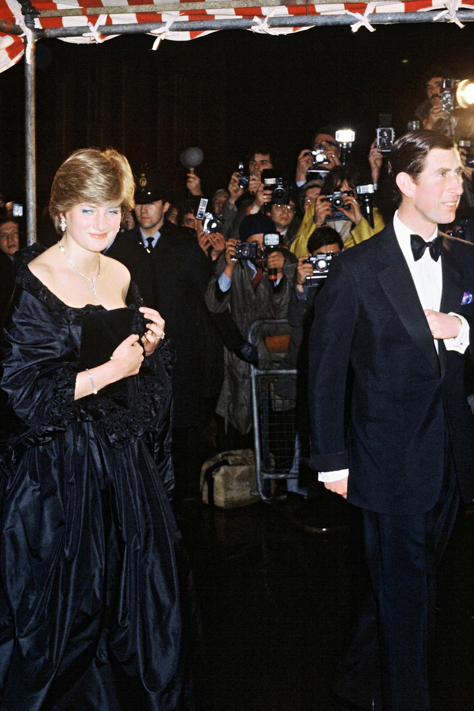 Lady Diana Spencer, later to become Diana, Princess of Wales, in an Emanuel black dress attending her first official engagement with Prince Charles in March 1981. (PA)