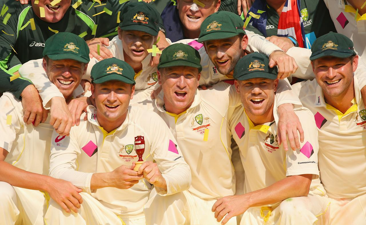 SYDNEY, AUSTRALIA - JANUARY 05:  The Australian team pose as they celebrate with the urn after winning the test and the series 5 - 0 during day three of the Fifth Ashes Test match between Australia and England at Sydney Cricket Ground on January 5, 2014 in Sydney, Australia.  (Photo by Mark Kolbe/Getty Images)