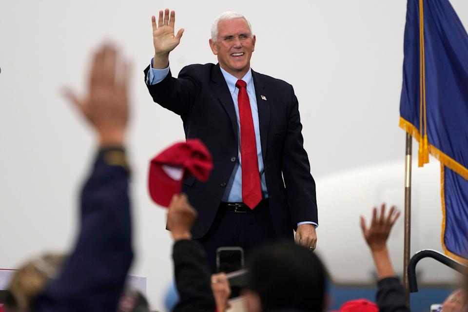 Vice President Mike Pence waves to supporters during a campaign rally, Wednesday, Oct. 21, 2020, in, Portsmouth, N.H.