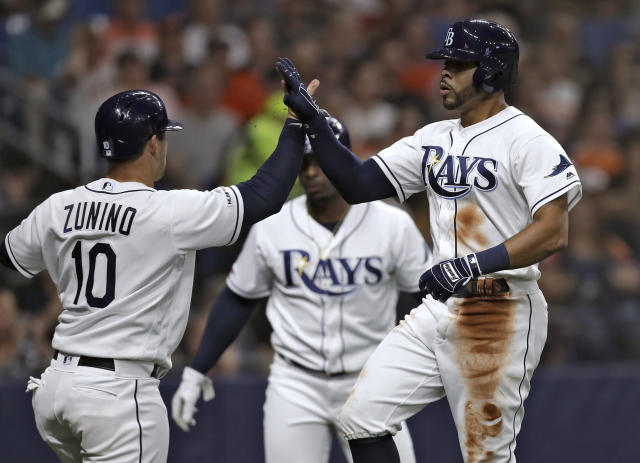 Tampa Bay Rays' Tommy Pham, right, celebrates with Mike Zunino after the pair scored on a two-run single by Ji-Man Choi off Houston Astros starting pitcher Gerrit Cole during the third inning of a baseball game Friday, March 29, 2019, in St. Petersburg, Fla. (AP Photo/Chris O'Meara)
