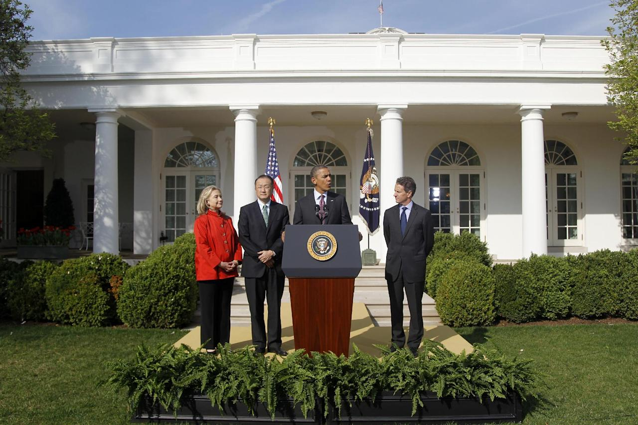 President Barack Obama stands with Jim Yong Kim, his nominee to be the next World Bank President, Secretary of State Hillary Rodham Clinton, and Treasury Secretary Timothy Geithner in the Rose Garden of the White House in Washington, Friday, March 23, 2012. Kim is currently the president of Dartmouth College. (AP Photo/ Haraz N. Ghanbari)