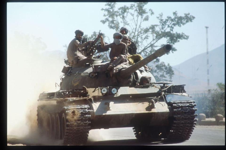 """<div class=""""inline-image__caption""""><p>Members of the Taliban army ride atop a tank October 15, 1996 near Kabul, Afghanistan. </p></div> <div class=""""inline-image__credit"""">Roger Lemoyne/Liaison/Getty</div>"""
