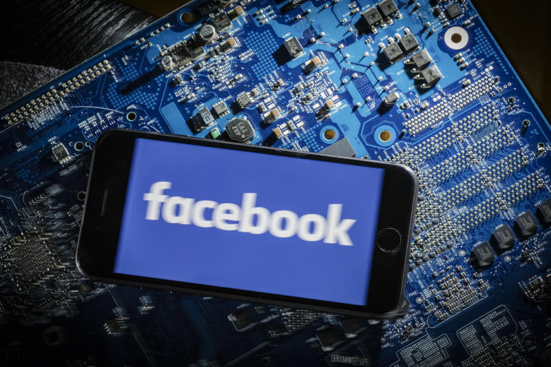 Berlin, Germany - March 20: In this photo illustration the logo of Facebook is displayed on a smartphone which is lying on a circuit board on March 20, 2018 in Berlin, Germany. (Photo by Thomas Trutschel/Photothek via Getty Images)