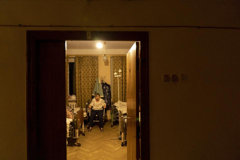 A patient with COVID-19 sits in a room at an hospital in Rudky, Western Ukraine, on Tuesday, Jan. 5, 2021. The government's wide-ranging lockdown closed schools, gyms and entertainment venues and prohibits table service at restaurants through Jan. 25. Ukraine, which has a population of 42 million, has reported more than 1.1 million confirmed coronavirus cases and nearly 20,000 deaths in the pandemic. (AP Photo/Evgeniy Maloletka)