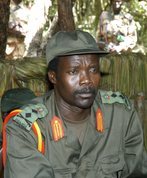 FILE - In this July 31, 2006 file photo, Joseph Kony, leader of the Lord's Resistance Army, looks on during a meeting with a delegation of 160 officials and lawmakers from northern Uganda and representatives of non-governmental organizations in the Democratic Republic of Congo near the Sudan border. Ten years ago the international treaty that created the ICC came into force, creating the world's first permanent war crimes tribunal. The head of a planned African Union force to hunt warlord Joseph Kony said on Wednesday, July 25, 2012, that he can't start his task because he doesn't have troops, equipment or the necessary funding. (AP Photo, File)