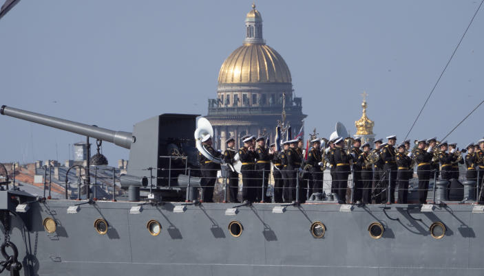A Navy orchestra perform on the deck of the Aurora cruiser during the Victory Day celebration amid the ongoing pandemic of the COVID-19 in St.Petersburg, Russia, Saturday, May 9, 2020. Victory Day, the anniversary of the defeat of Nazi Germany in World War II, is Russia's most important secular holiday and this year's observance had been expected to be especially large because it is the 75th anniversary, but military parades in Russian cities and a mass processions called The Immortal Regiment were postponed as part of measures to stifle the spread of the virus. (AP Photo/Dmitri Lovetsky)