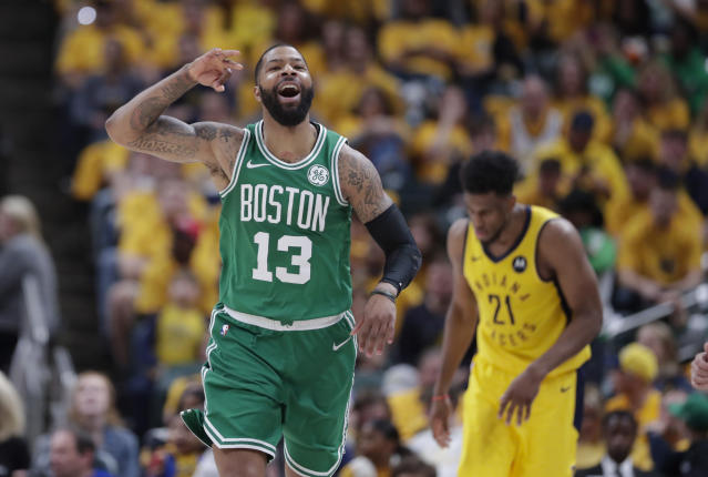 Boston Celtics forward Marcus Morris (13) celebrates during the second half of Game 4 against the Indiana Pacers in the NBA basketball first-round playoff series in Indianapolis, Sunday, April 21, 2019. The Celtics defeated the Pacers 110-106 to win the series 4-0. (AP Photo/Michael Conroy)