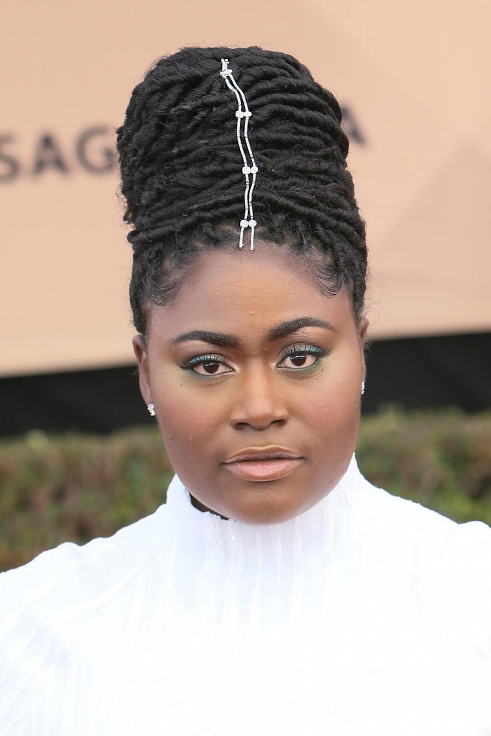 <p>All eyes were on the 'Orange Is The New Black' star as she opted for a quirky up-do, complete with a hair charm. Some rather striking green eye makeup completed the look. [Photo: Getty] </p>