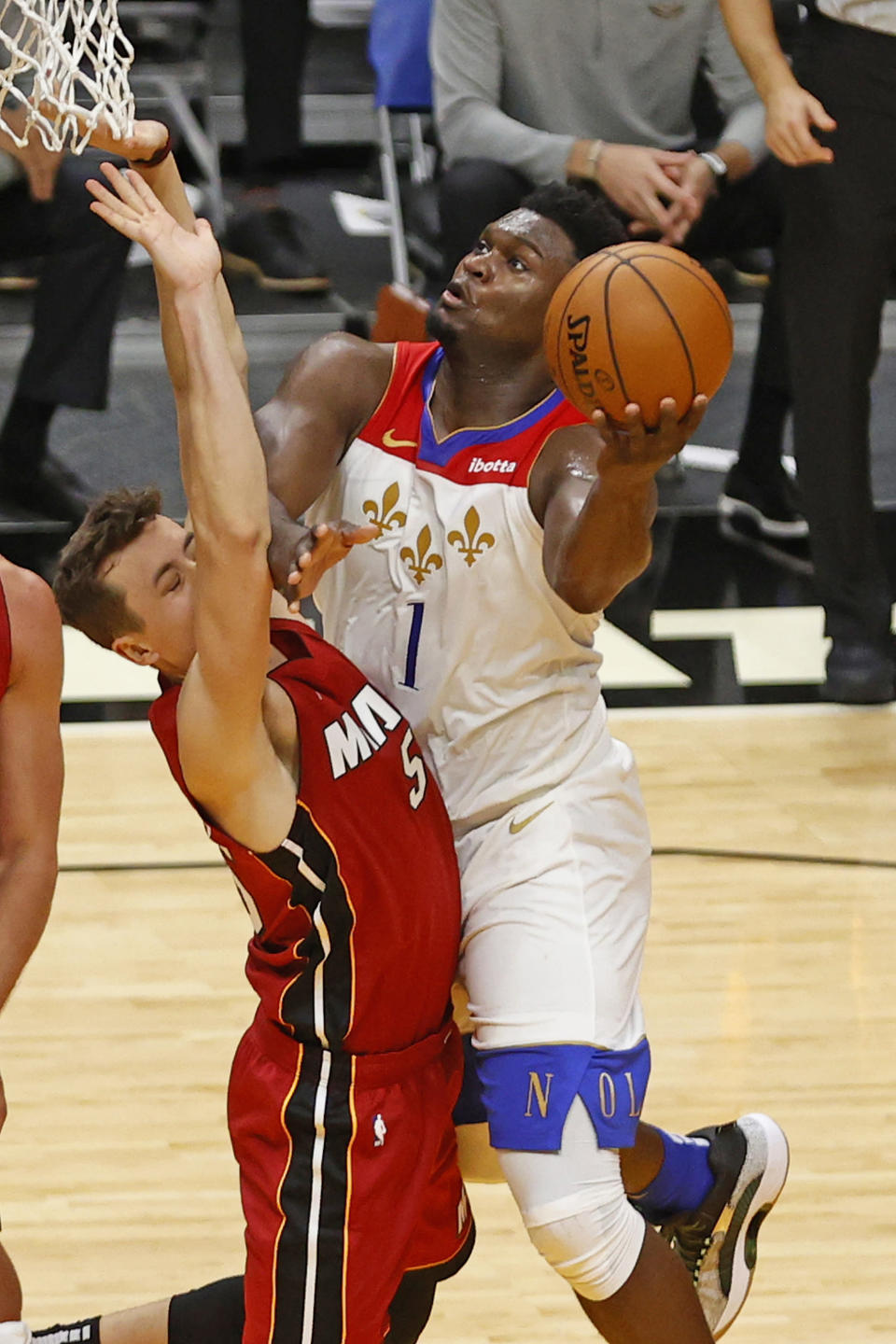 New Orleans Pelicans forward Zion Williamson (1) drives to the basket against Miami Heat forward Duncan Robinson (55) during the first half of an NBA basketball game, Friday, Dec. 25, 2020, in Miami. (AP Photo/Joel Auerbach)